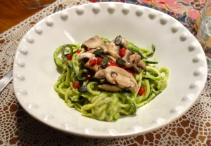 Voila!  Zucchini spaghetti with cremini mushrooms, smothered in avocado/ mint/ nut creamy sauce. YUM!